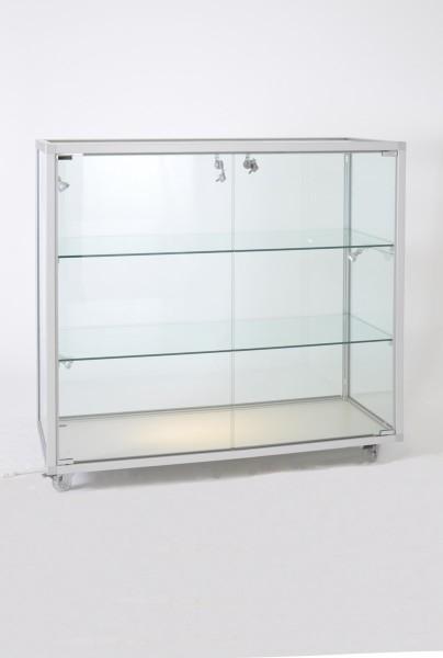 kleine Thekenvitrine mit Beleuchtung abschließbar   mit Glasrückwand / auf Rollen