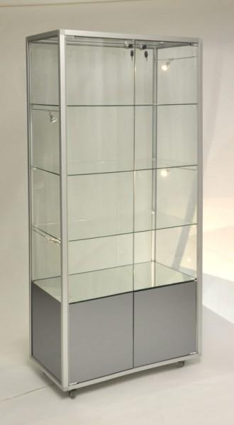 beleuchtete stehende Glasvitrine mit Staufach abschließbar 78 cm  ohne Spiegelrückwand / auf Rollen