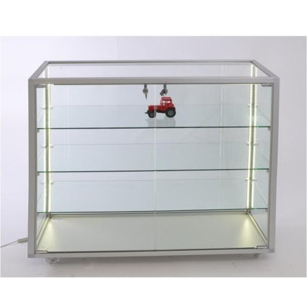 flache Thekenvitrine aus Glas abschließbar mit LED-Beleuchtung  auf Rollen